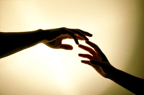 Hands reaching to each other - couple counselling can assist when the relationship needs a boost to restore the magic.